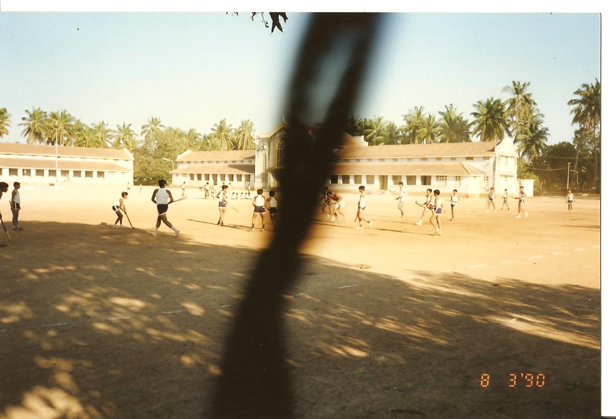 Evening games - Hockey played on the main athletic track and baseball in the backgroind on Madhyachogan - March 1990